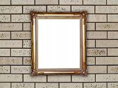 Golden Frame On Brick Stone Wall