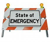 State of Emergency words on a road construction barricade or warning sign illustrating a dangerous c