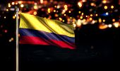 Colombia National Flag City Light Night Bokeh Background 3D