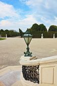 White marble staircase and antique bronze lantern. Schonbrunn - the summer residence of the Austria