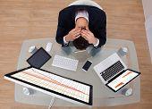 Frustrated Businessman Sitting At Desk