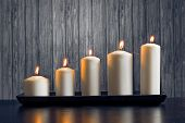 White Candles On Wood Table