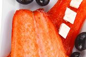 fresh grilled salmon meat fillet with goat light greek feta cheese black olives and tomatoes over lo