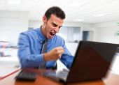 pic of angry man  - Angry man yelling at his computer - JPG