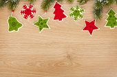 Christmas fir tree and decor on wooden board with copy space