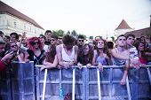BONTIDA - JUNE 19: Crowd of partying people during a live concert at Electric Castle Festival on Jun