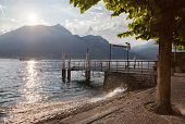 View of Como lake on sunset with pier in Bellagio, Italy
