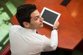 Young Man Working On Touchpad In Office