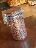 Coffee Beans In Glass Container.