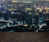 City night scene with wooden ground.