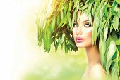 Beauty Girl with green leaves on her head. Beauty summer woman portrait. Beauty model in green wreat