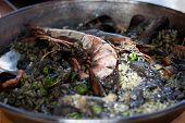 Paella negra in the pan