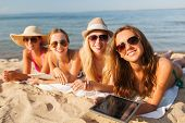 summer vacation, travel, technology and people concept - group of smiling women in sunglasses with t