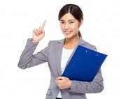 Businesswoman with clipboard and finger point up
