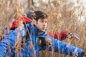 Male hikers in field