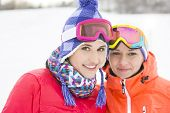 Portrait of happy young female friends in warm clothing outdoors