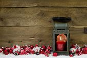 Wooden Christmas Background With Red Candle In A Latern And Snow.