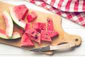 the sliced watermelon on kitchen table