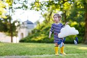 Cute Toddler Girl In Yellow Rubber Boots And Toy With Rain Drops