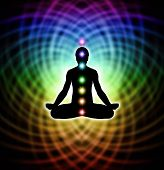 stock photo of guru  - Silhouette  of a man in lotus meditation position with Seven Chakras on rainbow colored matrix energy background - JPG