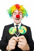 Clown with lollipop isolated on white