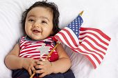 stock photo of american flags  - Proud Asian American Baby Girl Celebrating July Fourth - JPG