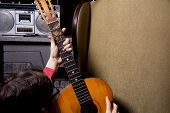 stock photo of guitar  - Man takes guitar - JPG