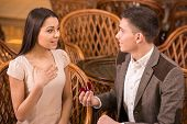 stock photo of propose  - Man is making proposal with the ring to his girlfriend at the restaurant - JPG
