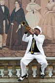 HAVANA, CUBA - JANUARY 8, 2015 : Black cuban musician playing the trumpet