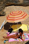 Woman sunbathing, Cadiz.