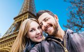 Beautiful Couple taking a selfie photo in Paris, France