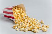 pic of popcorn  - Full popcorn in classic popcorn box on grey background - JPG