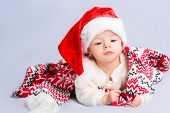 pic of christmas baby  - Beautiful little baby celebrates Christmas. New Year