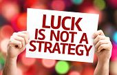 Luck is Not a Strategy card with colorful background with defocused lights