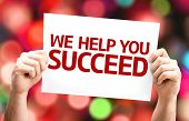 We Help You Succeed card with colorful background with defocused lights