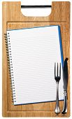 Empty Notebook On Wooden Cutting Board