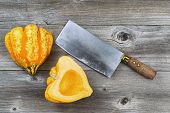Freshly Cut Squash With Large Knife On Rustic Wood