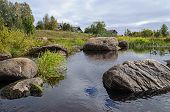 Large Boulders On The Shore Of Northern River
