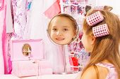 pic of jewel-case  - Beautiful small girl reflecting in round mirror with hair - JPG