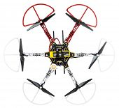 FORT COLLINS, CO, USA, January 14,  2015:  Radio controlled DJI  F550 Flame Wheel  hexacopter drone with carbon fiber propellers and LiPo battery. top view isolated on white.