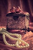 Antique jewellery casket with hearts and pearl necklace