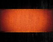 dark orange rustic canvas banner textured with dark wood background