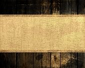 old rustic canvas banner textured with dark wood background