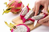 Chef's Hands Detaching Pulp From A Pitaya Wedge