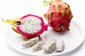 Pitaya Fruit Wedges, A Halved And A Whole Fruit