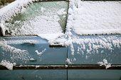 pic of windows doors  - snow fals on door and side windows of blue car - JPG