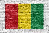 picture of reggae  - Reggae colors painted over white brick wall - JPG
