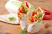 Burrito with chicken, beans, tomatoes and sweet peppers