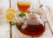 Hot  Tea  And Fresh Lemon Slices On  Wooden Table