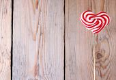 Heart Shaped Lollipop For Valentine's Day With Wooden Background